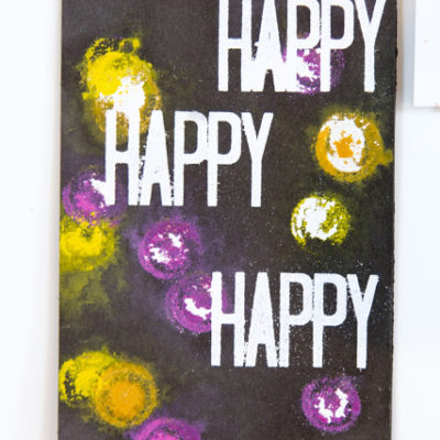 Happy Arty card featuring heat embossing and painted pattern by Taheerah Atchia