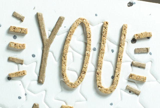 Close up of card featuring chipboard and cork die cut letters by Taheerah Atchia